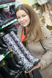 Satisfied customer with watertights in hands is in shop Stock Image