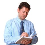 Satisfied Employee writes notes in notebook Royalty Free Stock Photos