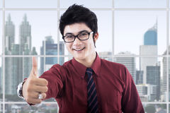 Satisfied entrepreneur showing thumb up Royalty Free Stock Photography