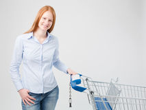 Satisfied Female Customer with Shopping Cart Stock Image
