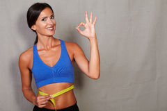 Satisfied female showing toothy smile and ok sign Royalty Free Stock Photos