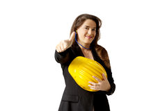 Satisfied female  yard foreman with safety helmet over white bac Royalty Free Stock Image
