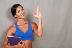 Satisfied fitness lady showing ok sign Royalty Free Stock Photo