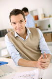 Satisfied and friendly man in office Stock Image