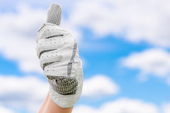 Satisfied gesture of hand in a glove golf Royalty Free Stock Photos