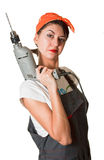 Satisfied girl with drill Royalty Free Stock Photography