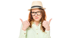 Satisfied girl in a hat holding thumbs up Stock Photography