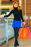 Satisfied girl with shopping bags Royalty Free Stock Images