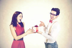 Satisfied guy  giving special gift to his girlfriend Royalty Free Stock Photo