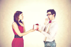 Satisfied guy  giving special gift to his girlfriend Stock Photography