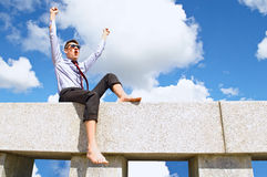 Satisfied with a guy on the roof Stock Image
