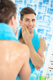 Satisfied handsome man aftershave Stock Photography