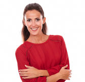 Satisfied hispanic woman with crossed arms. Portrait of satisfied hispanic woman on red shirt with crossed arms smiling at you on isolated studio stock image