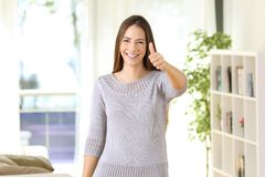 Satisfied home owner looking at camera. Front view portrait of a satisfied home owner looking at camera standing in a house interior Royalty Free Stock Image