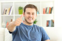 Satisfied home owner looking at you with thumbs up Stock Photo