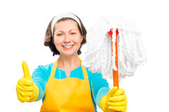 Satisfied housewife with a mop showing hand gesture Royalty Free Stock Photography
