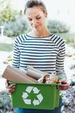 Satisfied housewife using recycling system Stock Photos