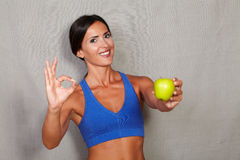 Satisfied lady showing apple and ok sign Stock Photo