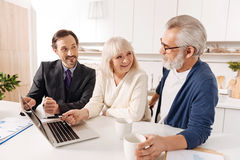 Satisfied lawyer discussing plan of contract with clients Stock Images