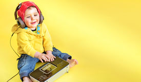Satisfied little boy listening to music stock photography
