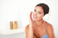 Satisfied lovely female listening to music Stock Photography