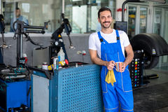 Satisfied male engineer. In an auto repair shop Royalty Free Stock Photo