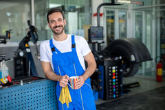 Satisfied male mechanic. In an auto repair shop Stock Image