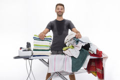 Satisfied man behind ironing board Stock Images