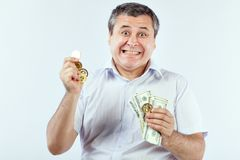Satisfied man with bitcoins. Royalty Free Stock Image