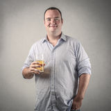 Satisfied man. With a glass of bier in his hands Royalty Free Stock Image