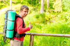 Satisfied man goes camping Stock Images