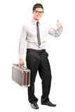Satisfied man holding a briefcase Stock Image