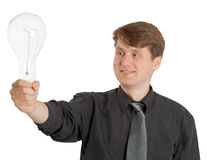 Satisfied man holding a light bulb Stock Images