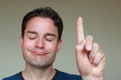 Satisfied man pointing his finger right up Stock Photography