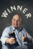 Satisfied man with thumb up and winner cup Royalty Free Stock Photo