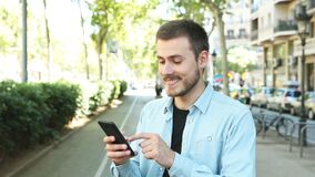 Atisfied man using phone with thumb up stock video footage