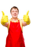 Satisfied man wearing gloves and apron Stock Image