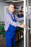 Satisfied manager at PVC windows factory royalty free stock photo