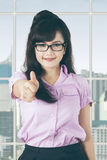 Satisfied manager with thumb up in office Royalty Free Stock Images