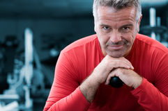 Satisfied mature man at gym Royalty Free Stock Photos