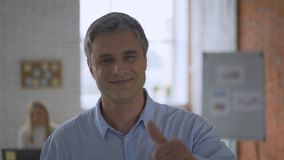 Satisfied mature man with thumb up. Happy caucasian man showing gesture ok. Cheerful european middle-aged guy. 4K. Satisfied mature man with thumb up. Happy stock video