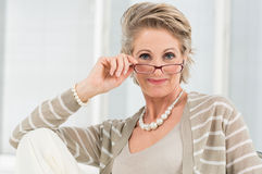 Satisfied Mature Woman Wearing Eyeglass Royalty Free Stock Photos