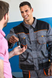 Satisfied mechanic returns the key Stock Photography