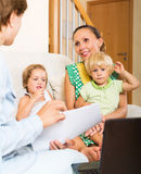 Satisfied mother arranging mortgage details Royalty Free Stock Photography