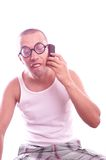 Satisfied nerd in eyeglasses calls by mobile phone Stock Photo