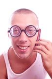 Satisfied nerd in eyeglasses calls by mobile phone Stock Image