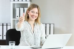 Satisfied office employee looking at you royalty free stock photography