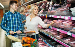 Satisfied positive family couple choosing chilled meat Royalty Free Stock Photo