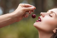 Satisfied pretty temptation woman cherry concept. Royalty Free Stock Photos