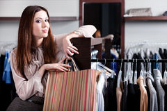 Satisfied with purchases woman carries paper bags Royalty Free Stock Photo